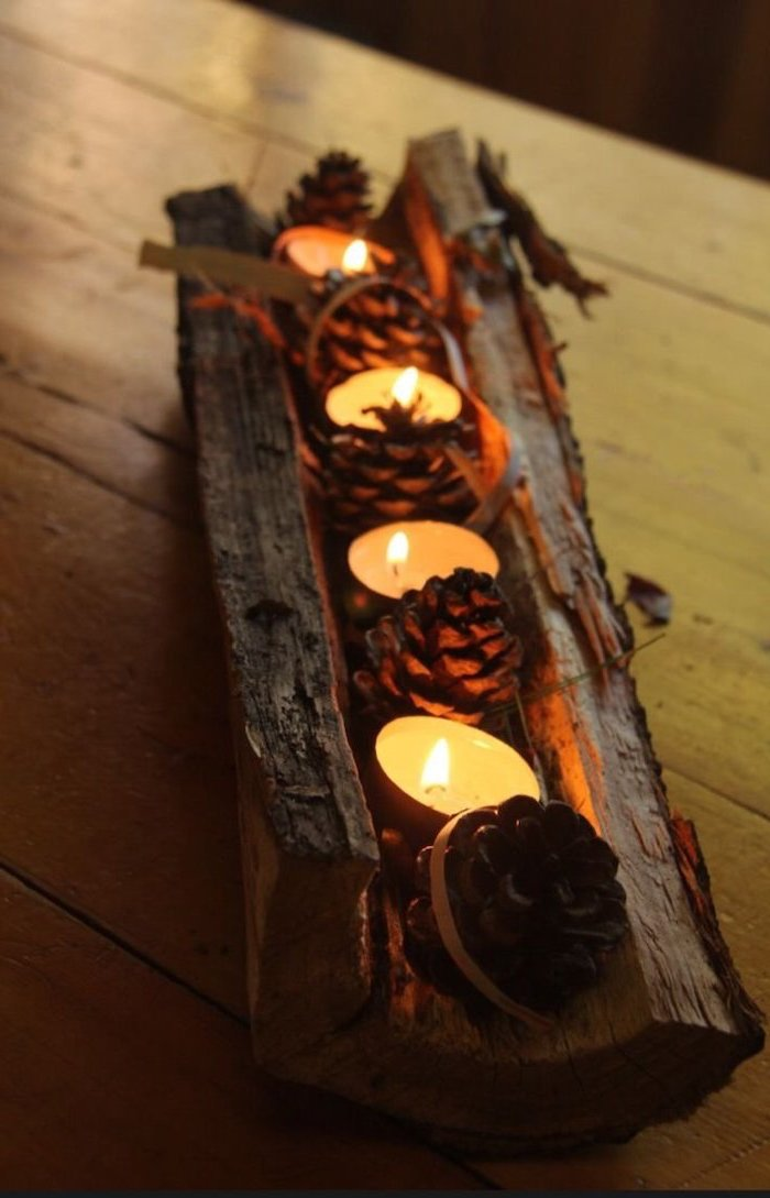 pine cones and candles, inside a wooden log, pinterest thanksgiving, wooden table