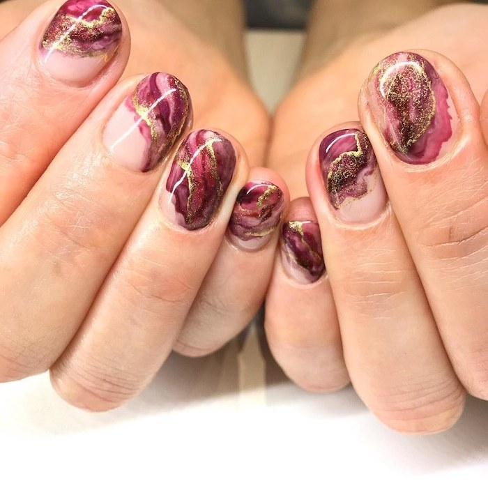 purple and pink, gold glitter, marble nails, neutral nail colors, short squoval nails, white table