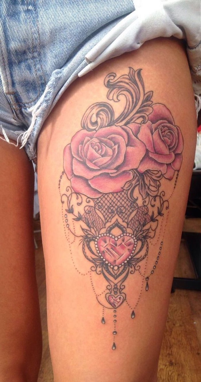 denim shorts, rose thigh tattoo, two pink roses, pink heart shaped crystals, wooden floor