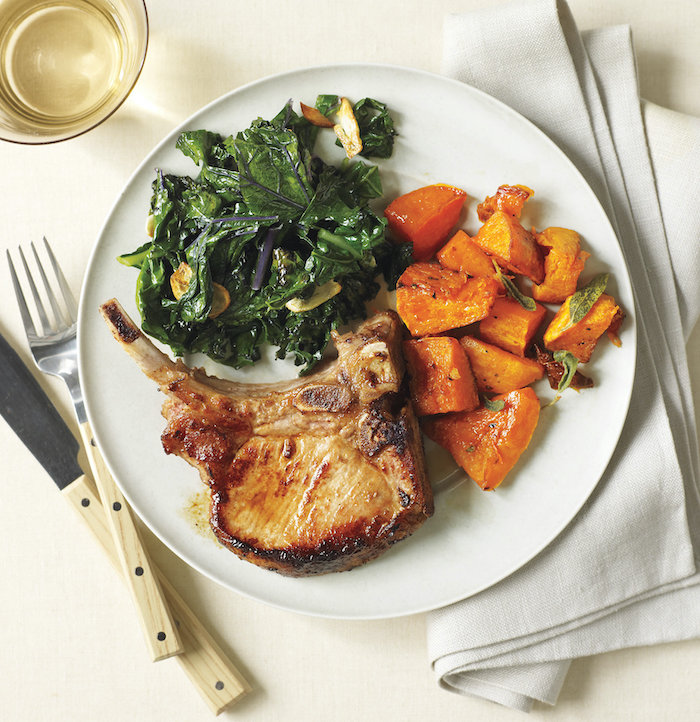 pork with cooked spinach and pumpkin, in white plate, what to make for dinner tonight, white cloth, white table