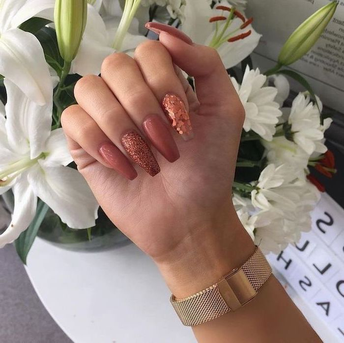 burnt orange nails, dark pink, pink glitter, nail polish, long coffin nails, white flower bouquet, gold watch