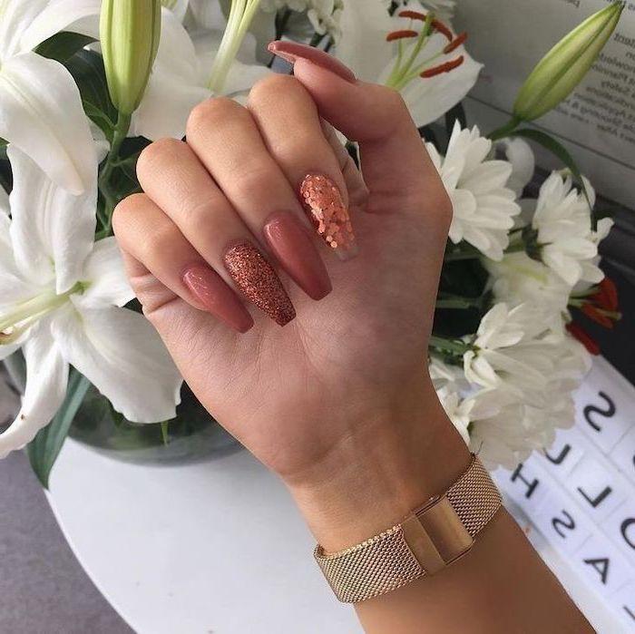 burnt orange nails, dark pink, pink glitter, nail polish, long coffin nails, white flower bouquet, gold watch