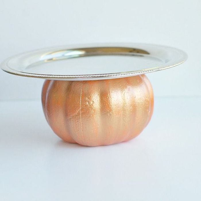 white background, thanksgiving decorations diy, pumpkin painted in gold, silver tray attached to it