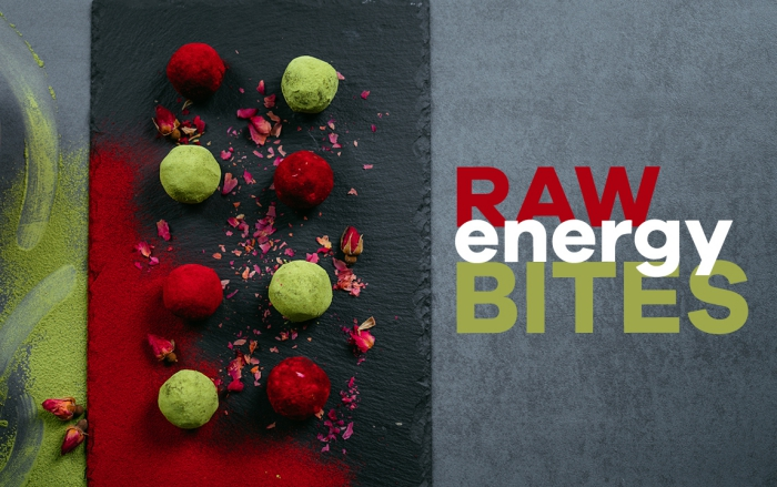 raw energy bites, black cutting board, peanut butter protein balls, covered in cocoa, dyed in green and red