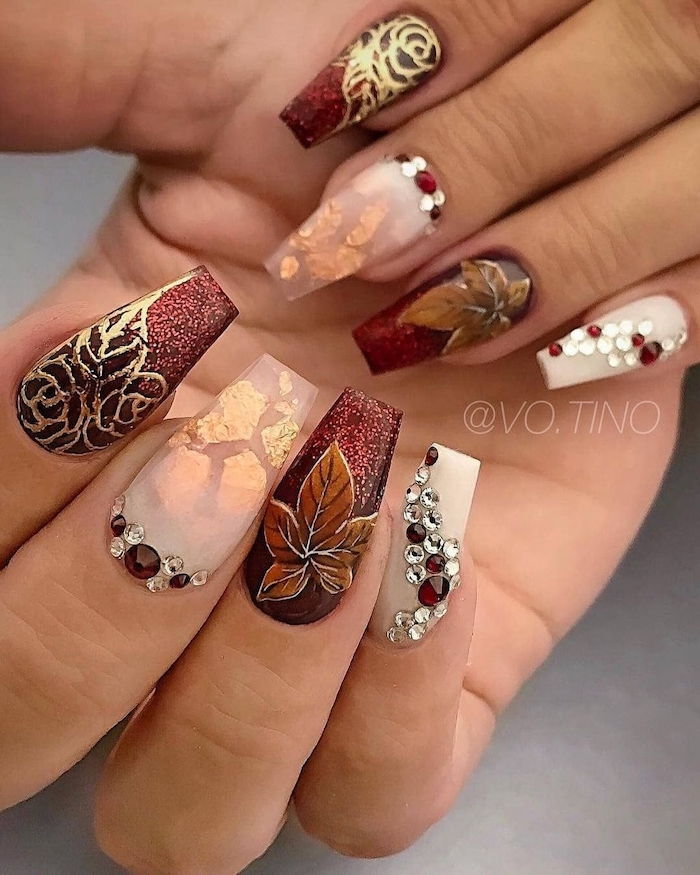 dark red glitter, nude nail polish, gold glitter, rhinestones on nails, nail decorations, burnt orange nails, coffin nails