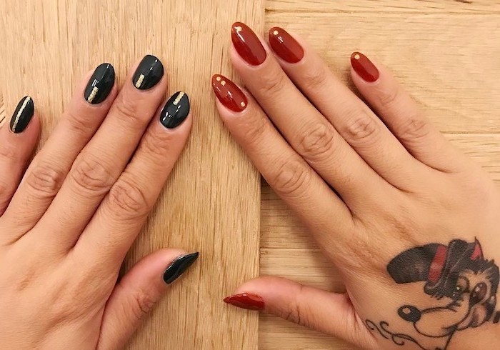 thanksgiving nail colors, two different manicures, black and red nail polish, hand tattoo, wooden table