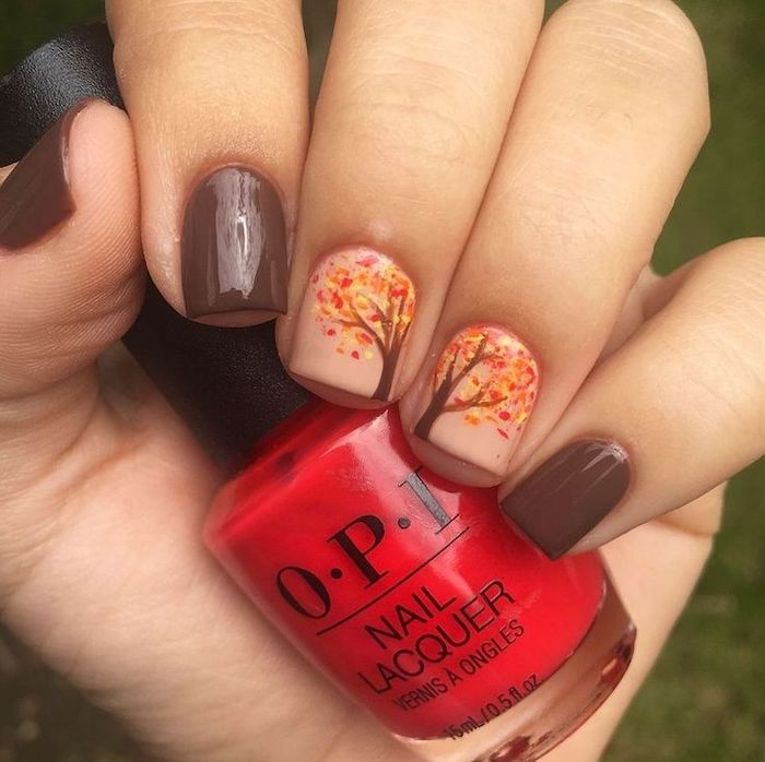 brown and nude, nail polish, thanksgiving nail colors, tree with orange, yellow leaves, nail decorations