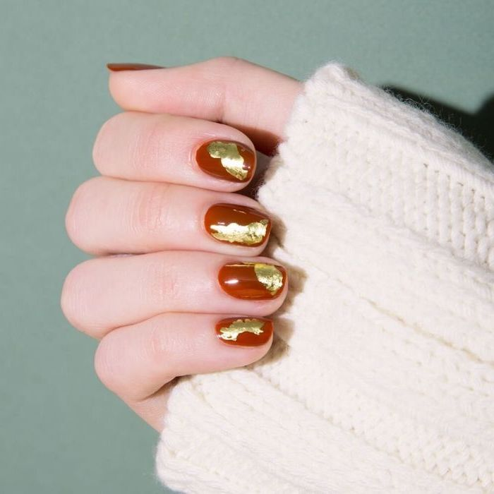dark red, nail polish, thanksgiving nail colors, gold glitter, nail decorations, short squoval nails, white sweater