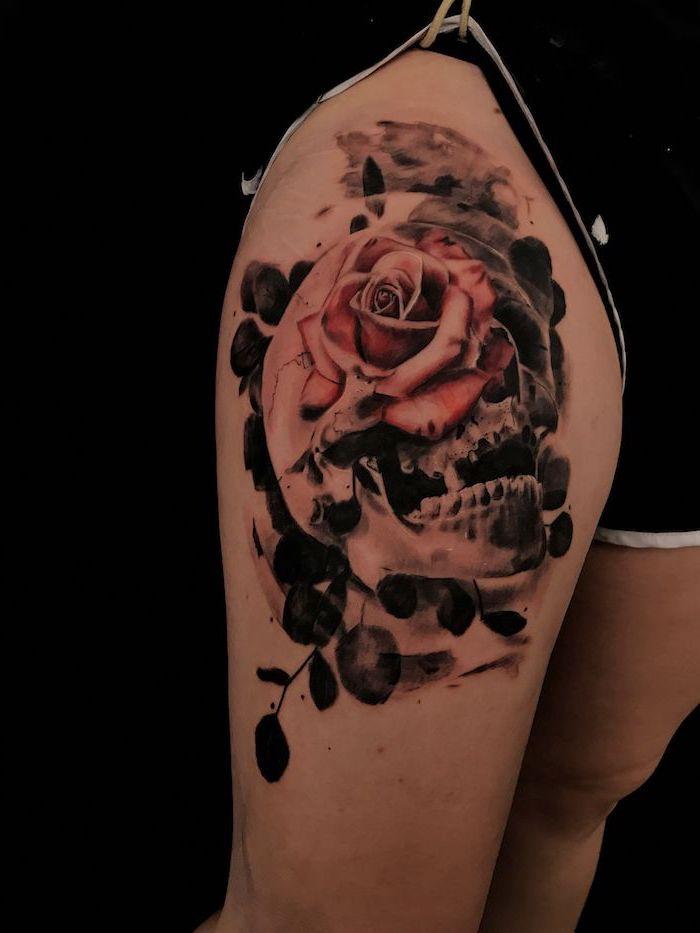 human skull, red rose, leg tattoos for girls, black shorts, black background