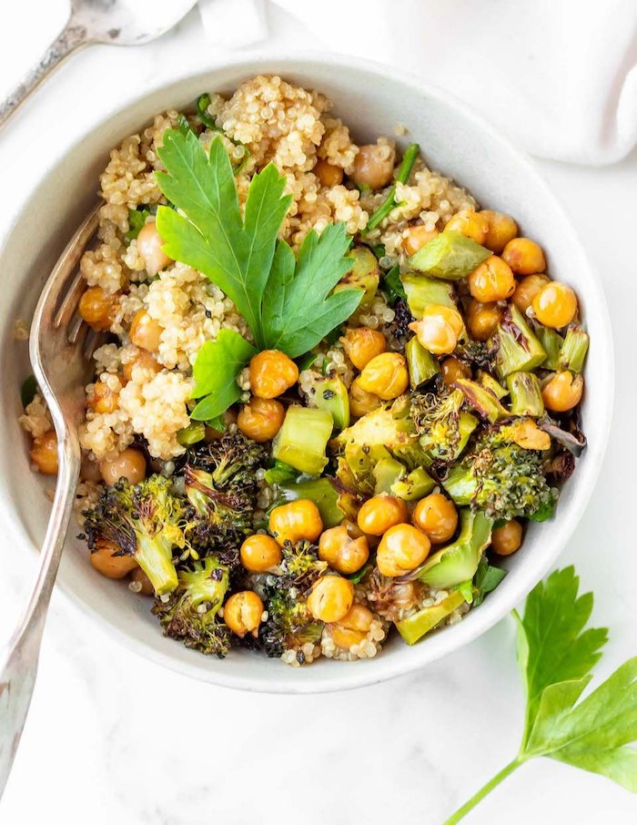 quinoa with chickpeas, broccoli and avocado, in white bowl, healthy dinners for two, white table, white cloth