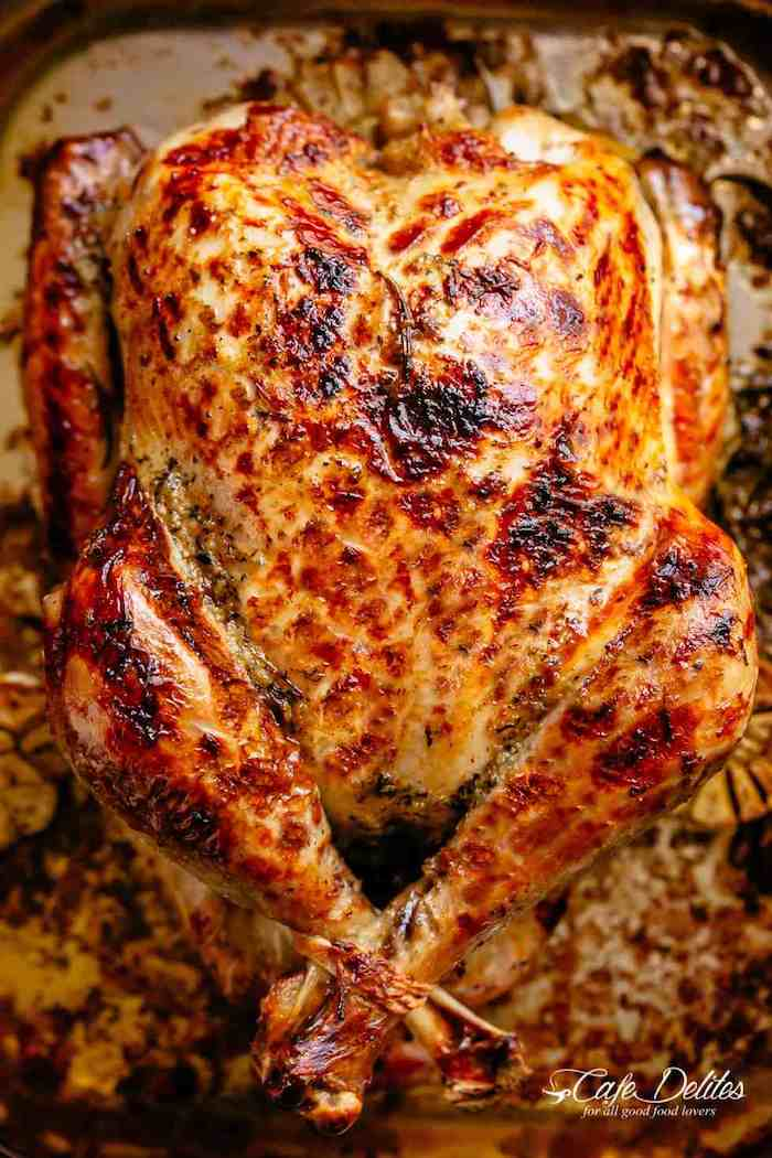 roasted turkey, how long to cook a turkey, covered with herbs and butter, in a pan