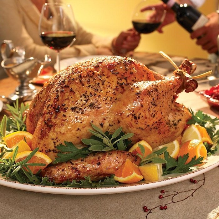 wine glasses, roasted turkey, fresh herbs, lemon slices, on the side, how to cook a thanksgiving turkey, white plate