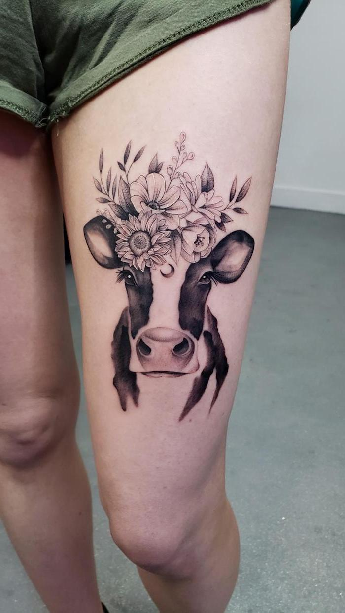 green shorts, cow with floral crown, rose thigh tattoo, white background