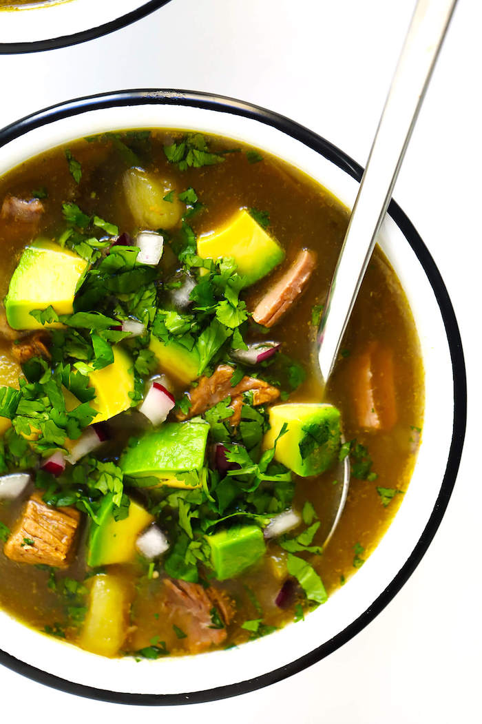 steak soup, weight loss diet, avocado slices, parsley garnish, in white bowl, silver spoon, white table
