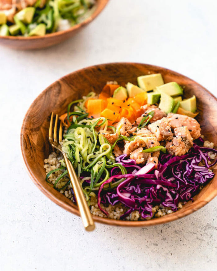 dinner ideas for tonight, spiralised carrots and zucchini, avocado and quinoa, seared salmon, in wooden bowls