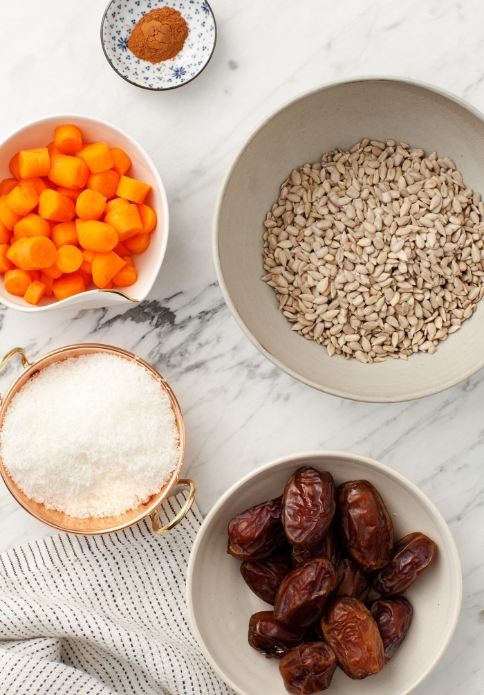 ingredients in white bowls, on marble countertop, peanut butter oatmeal balls, white cloth