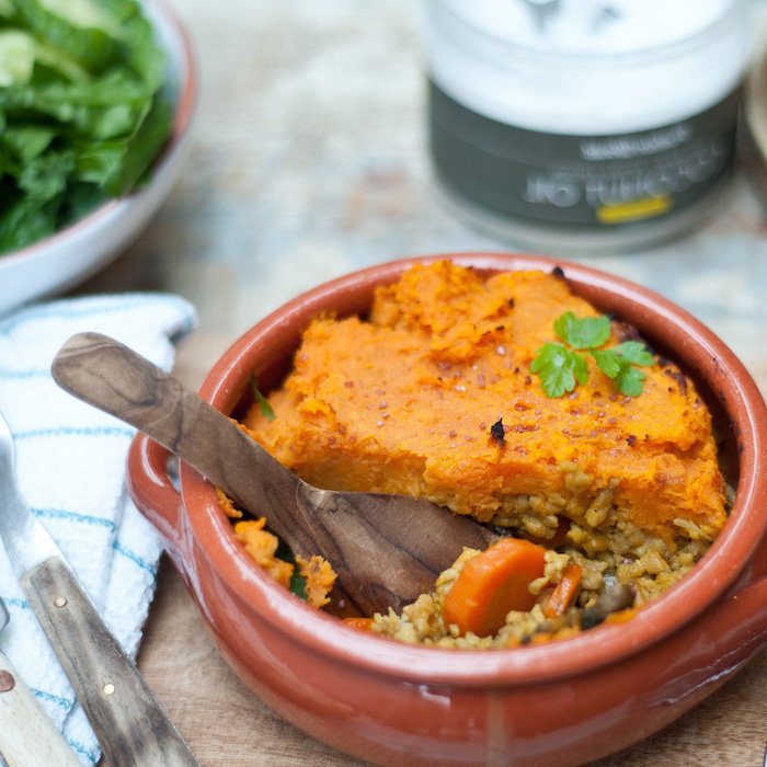 shepherd pie, in a ceramic bowl, pumpkin squash on top, simple meal plan to lose weight, rice inside, wooden spoon