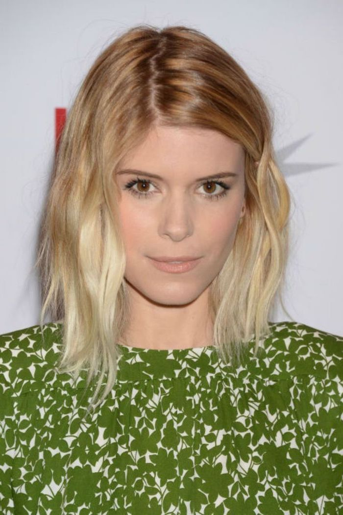 kate mara with blonde balayage hair, wearing green dress, layered haircuts with bangs, white background
