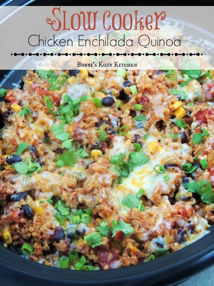 chicken enchilada quinoa, with black beans, cooked in black skillet, easy weeknight dinners, parsley for garnish