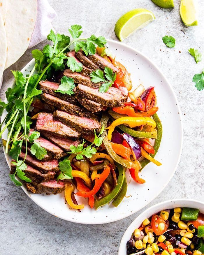 weight loss diet, steak fajitas, sliced peppers, parsley garnish, on white plate, lime slices, on the side