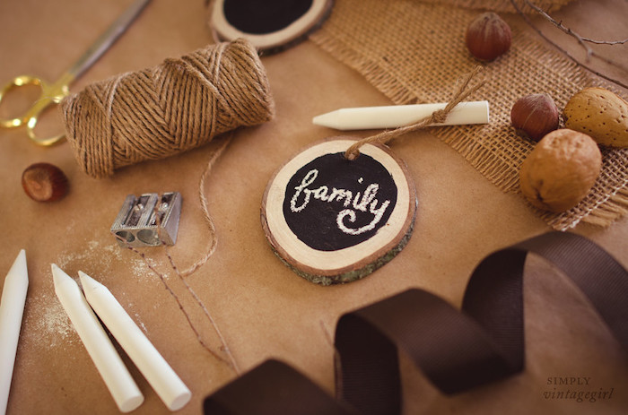 chalkboard on small wooden piece, chalk and scissors, thanksgiving decorating ideas, brown ribbon