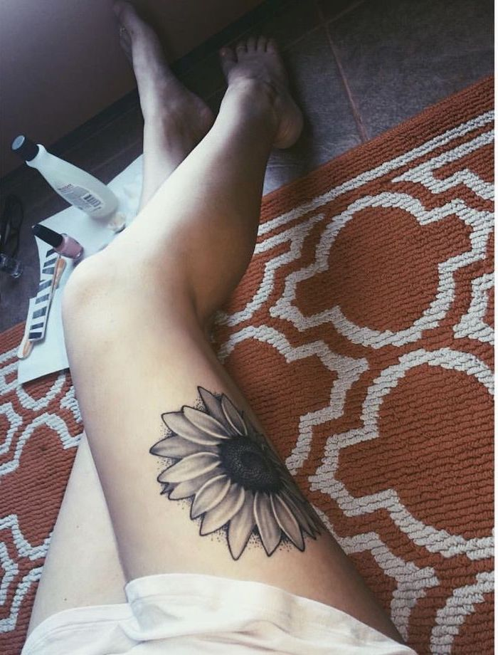 orange carpet, nail polish, sunflower tattoo, upper thigh tattoo, tiled floor