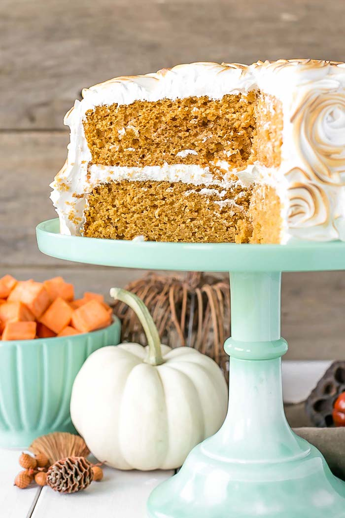 thanksgiving desserts, turquoise cake stand, sweet potato cake, roasted marshmallow fluff on top, wooden table