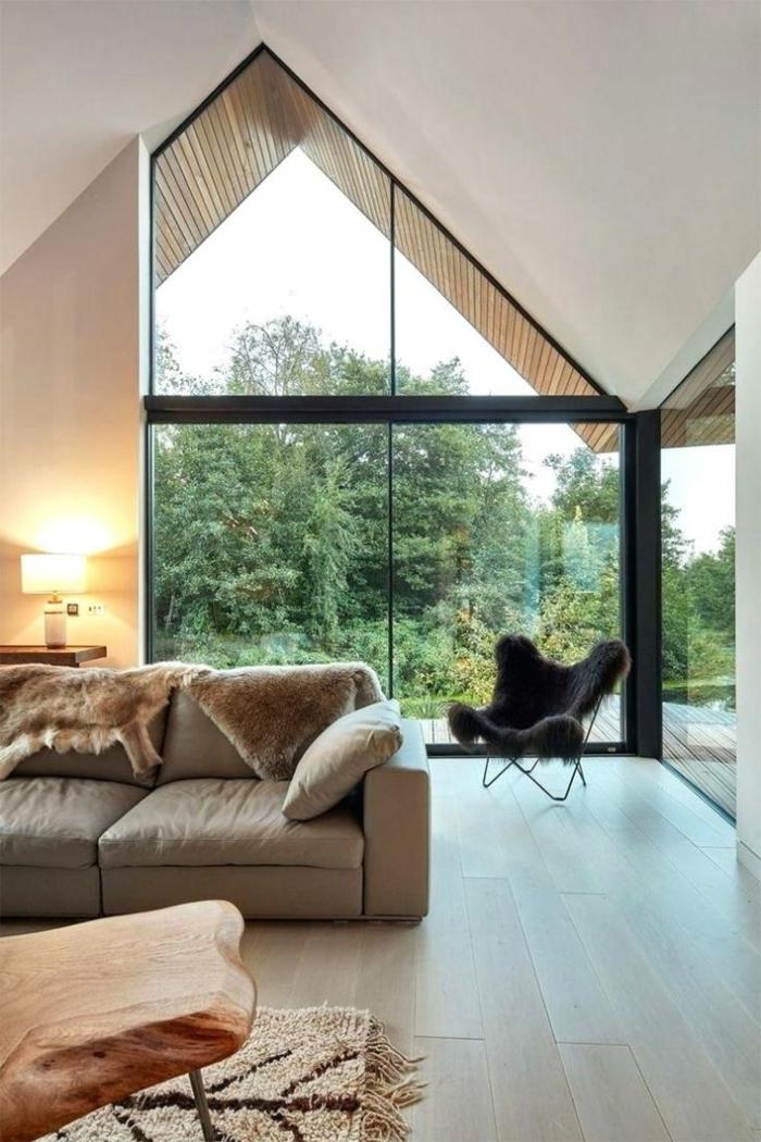 black armchair, grey sofa, wooden table, how to vault a ceiling, wooden floor, tall windows