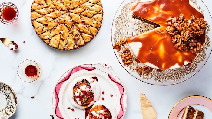 different desserts, tart and cake, best thanksgiving pies, glass cake stand, marble countertop, water glasses