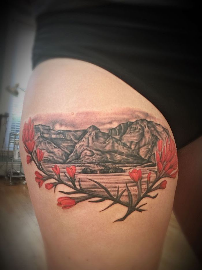 black shorts, upper thigh tattoo, mountain landscape, red flowers, wooden floor