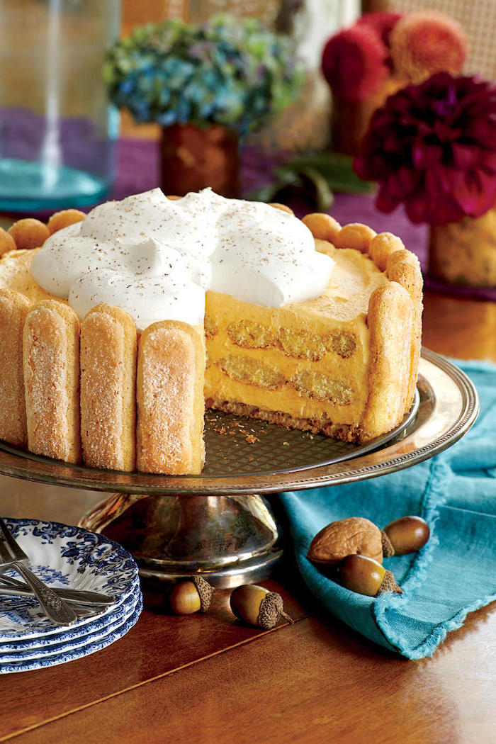 best thanksgiving pies, cake stand, cake with biscotti, cream on top, blue cloth, wooden table