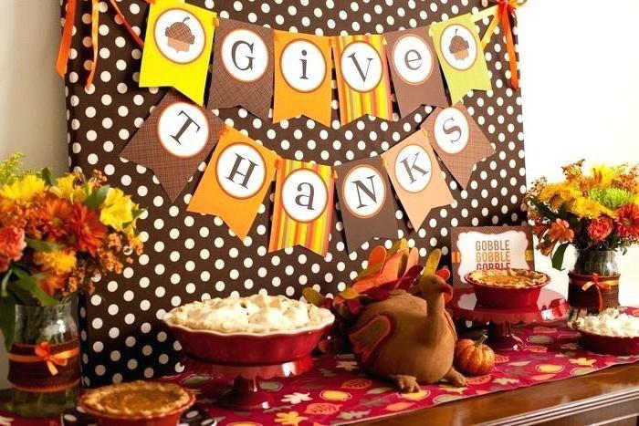 give thanks banner, stuffed toy turkey, thanksgiving home decorations, flower bouquets, dessert table