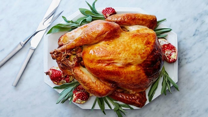 fresh herbs, pomegranate seeds, on the side, roasted turkey, white plate, best thanksgiving turkey recipe