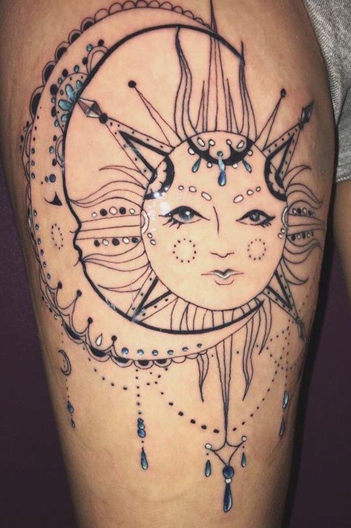 moon and sun, blue beads, mandala tattoo, lion thigh tattoo, grey shorts