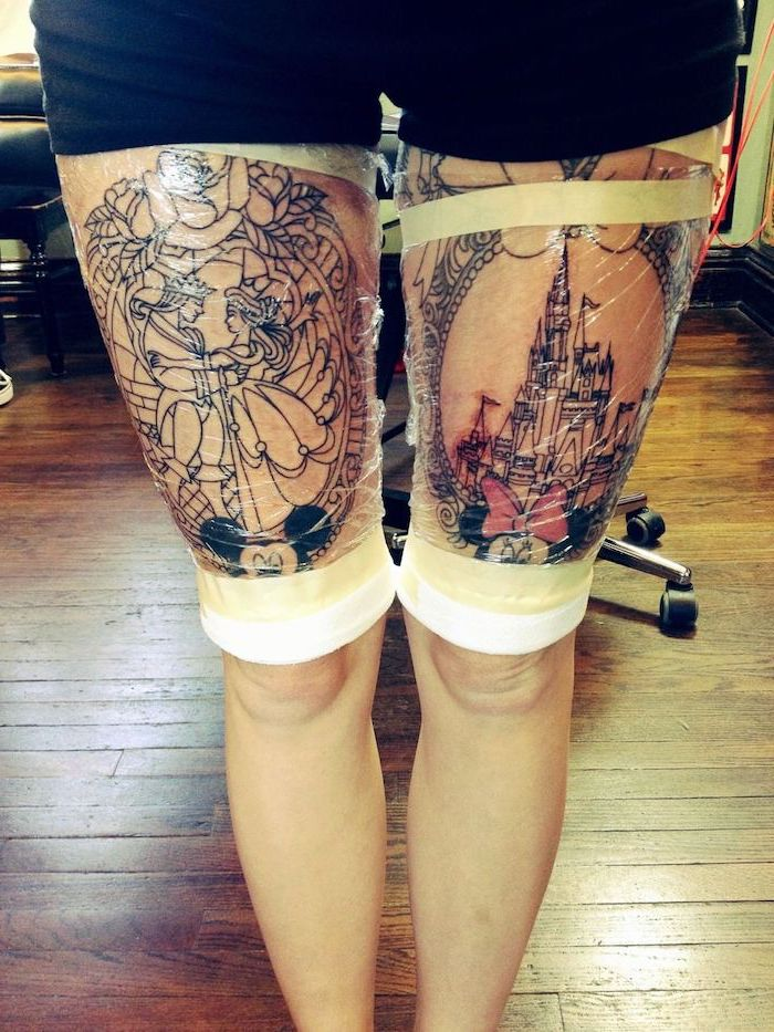 beauty and the beast, disney castle, tattoos on both legs, wooden floor, lion thigh tattoo, disney inspired