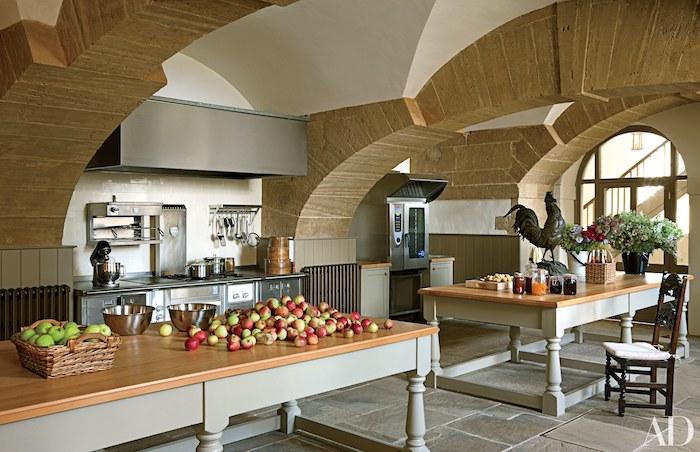 wooden kitchen islands, stone tiles on the ceiling, vaulted ceiling lighting, tiled floor, metal kitchen