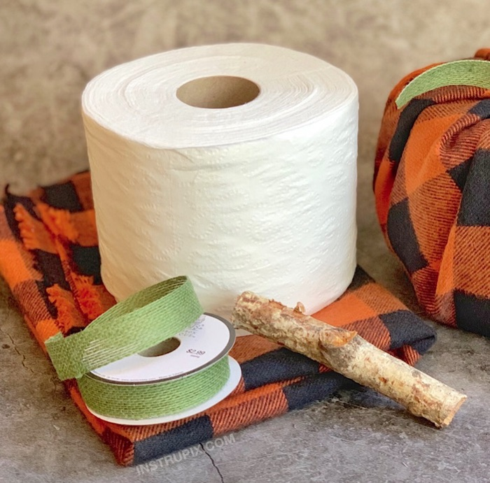 flannel table cloth, toilet paper roll, green ribbon, wooden stick, fall decor, step by step, diy tutorial