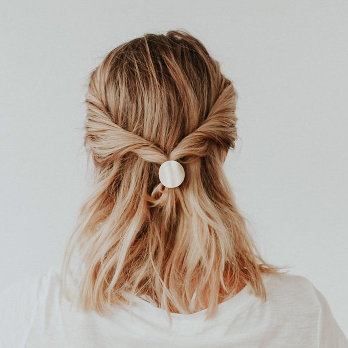 twisted half ponytail, on woman with blonde hair, wearing white blouse, shoulder length hairstyles, white background