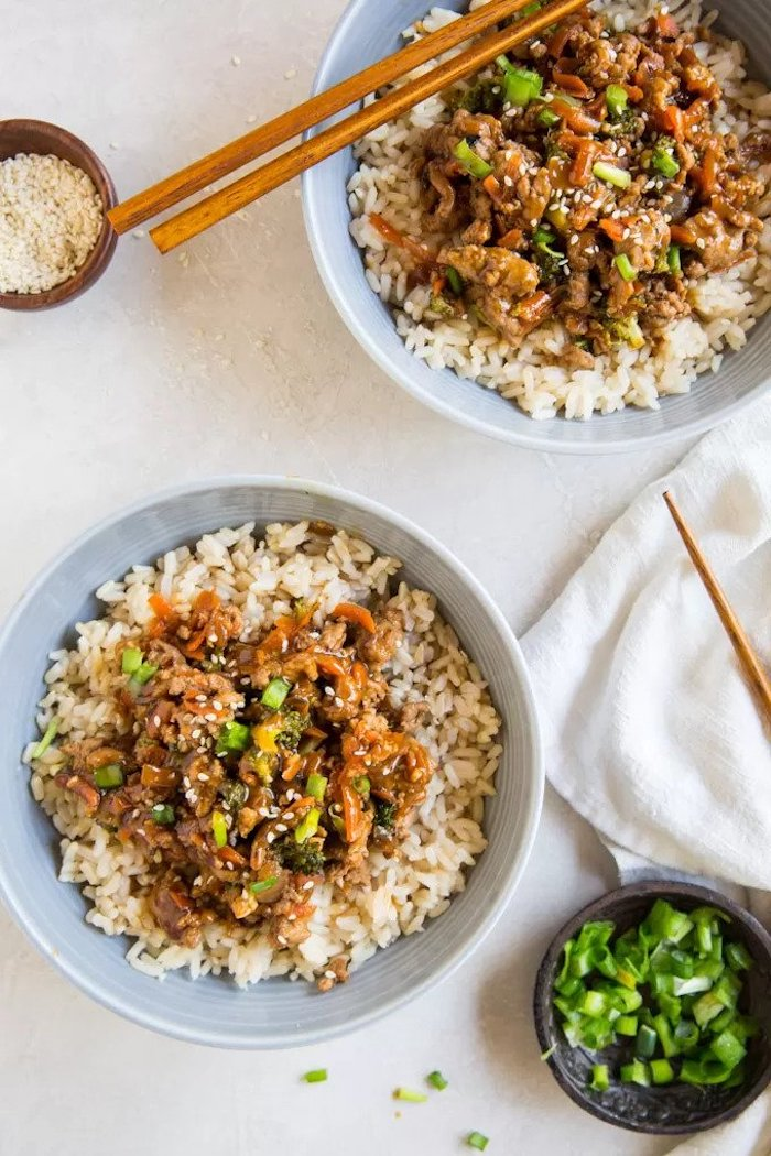 two bowls, teriyaki chicken, rice bowls, dinner ideas for two, wooden chopsticks, white table, white cloth