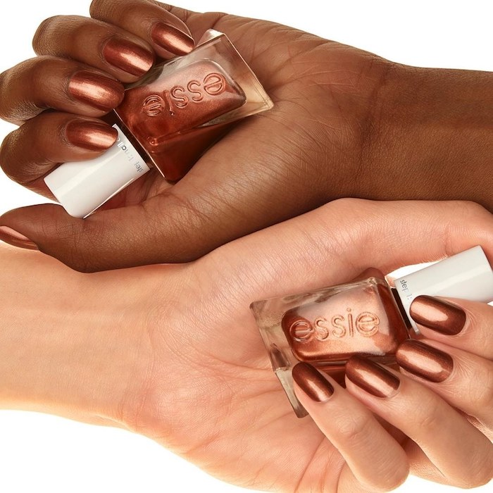two hands, holding nail polish bottles, pretty nail colors, golden brown, nail polish, pretty nail colors, short nails