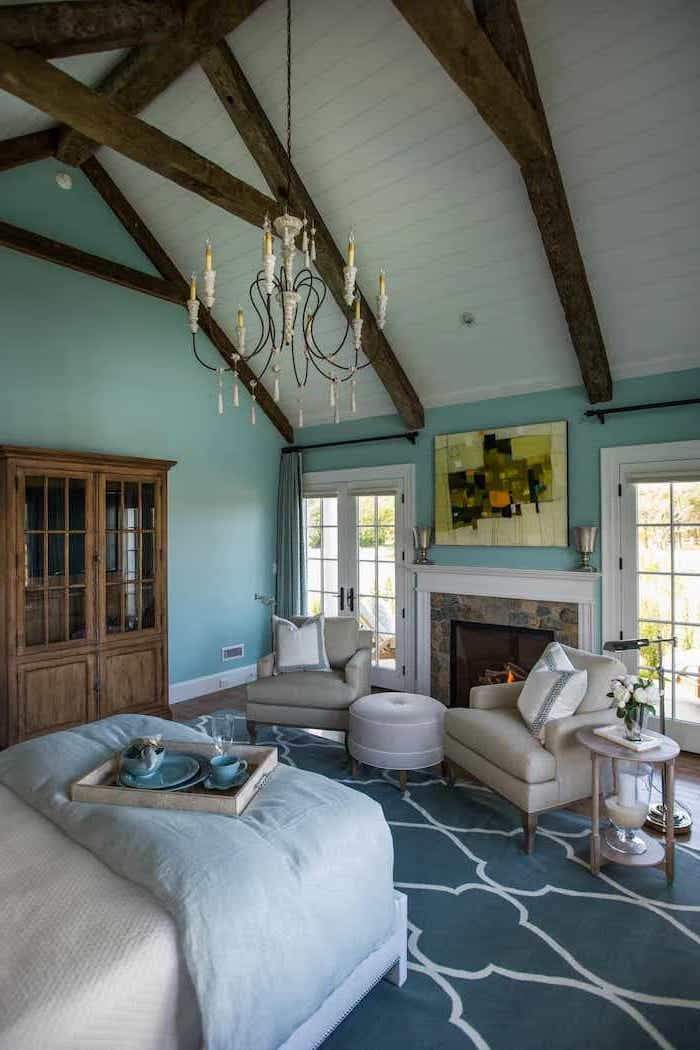 hanging chandelier, blue carpet, turquoise walls, vaulted ceiling kitchen, wooden cupboard, rustic decor