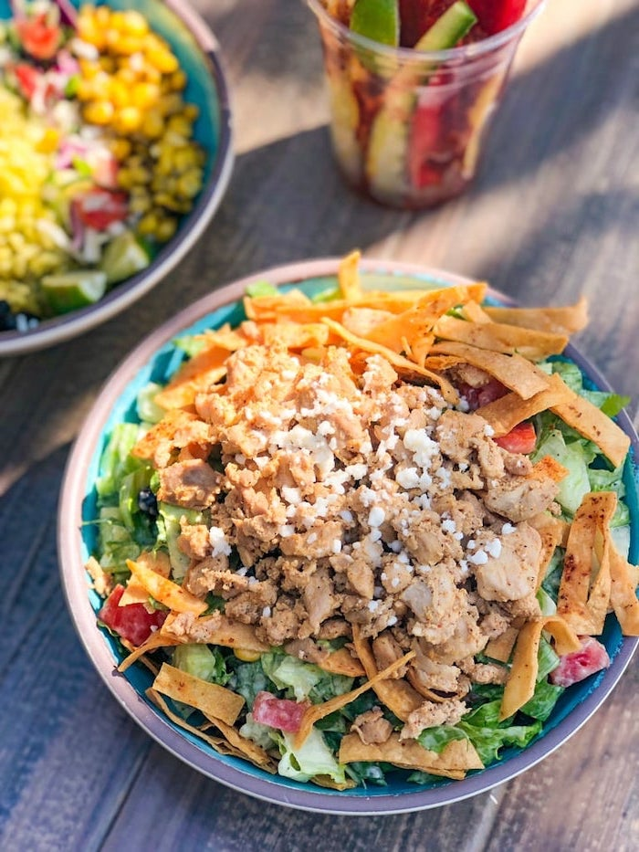 foods to avoid to lose weight, tortilla wraps, with green salad, chopped pork, parmesan on top