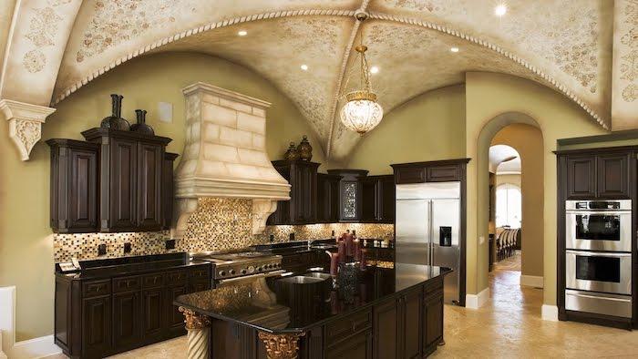 vaulted vs cathedral ceiling, black cupboards, kitchen island, mosaic backsplash, tiled floor