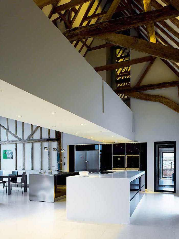 white kitchen island, vaulted vs cathedral ceiling, wooden beams, white bridge, white tiled floor