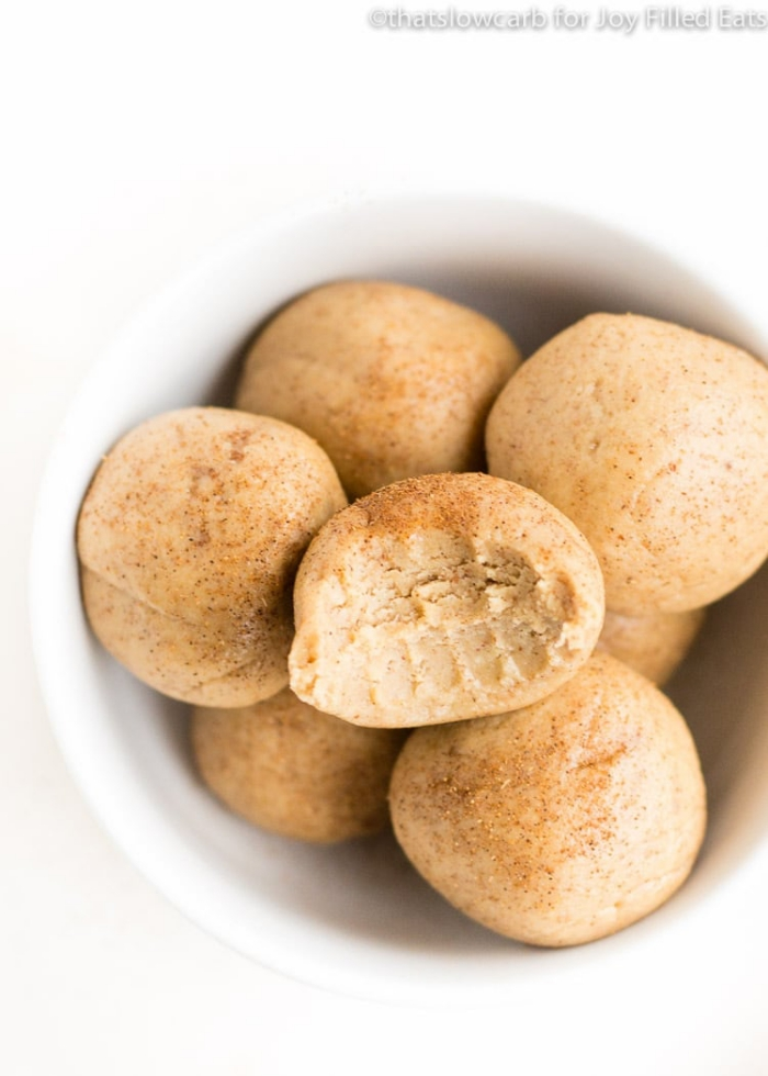healthy energy balls recipe, with peanut butter, cinnamon powder on top, in white bowl