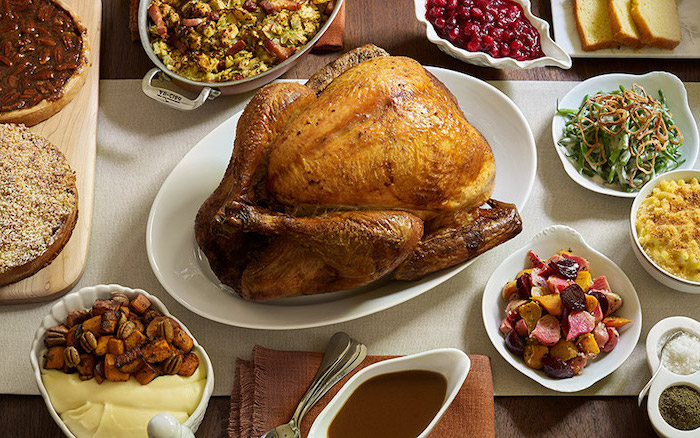 cranberry sauce, gravy in a jug, roasted turkey, best thanksgiving turkey recipe, white bowls, wooden table