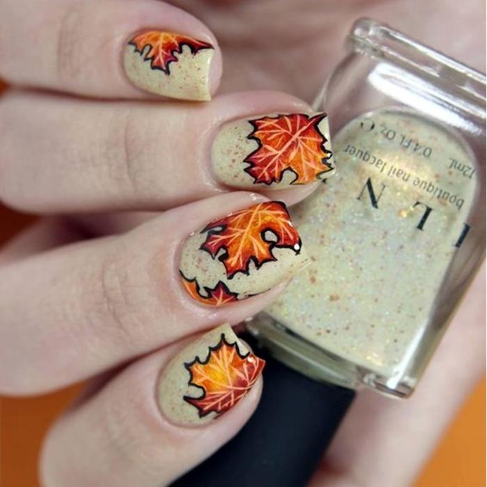 september nail colors, white glitter, nail polish, orange and yellow, fall leaves, nail decorations, square nails