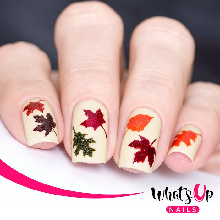 white nail polish, popular nail colors, orange and red, green and purple, glitter fall leaves, short nails
