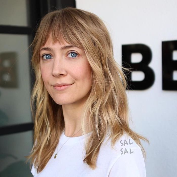 woman wearing white t shirt, medium hairstyles 2019, blonde wavy hair with bangs, white background