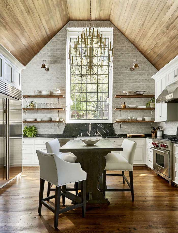 brick wall, open shelving, what does vaulted mean, hanging chandelier, wooden floor, wooden table